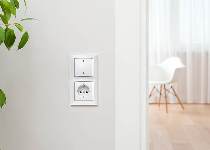 The wall switch is in the bright, contemporary interior. Open th